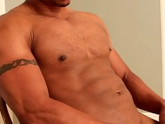 Beefy black stud strips down and jerks off