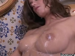 Perfect doll is exposing her opened spread kitty in close up