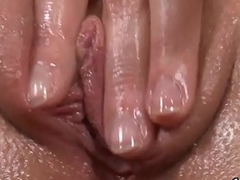Sweet cutie is gaping wet cunt in closeup and having orgasm
