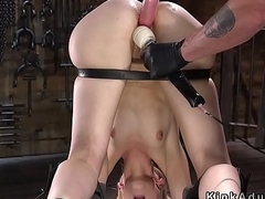 Device bondage with stakes on blonde